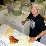 Roger Greenwood with ICL Imaging after applying Large Format Printed Graphics onto custom sinks for Burts Bees promotion