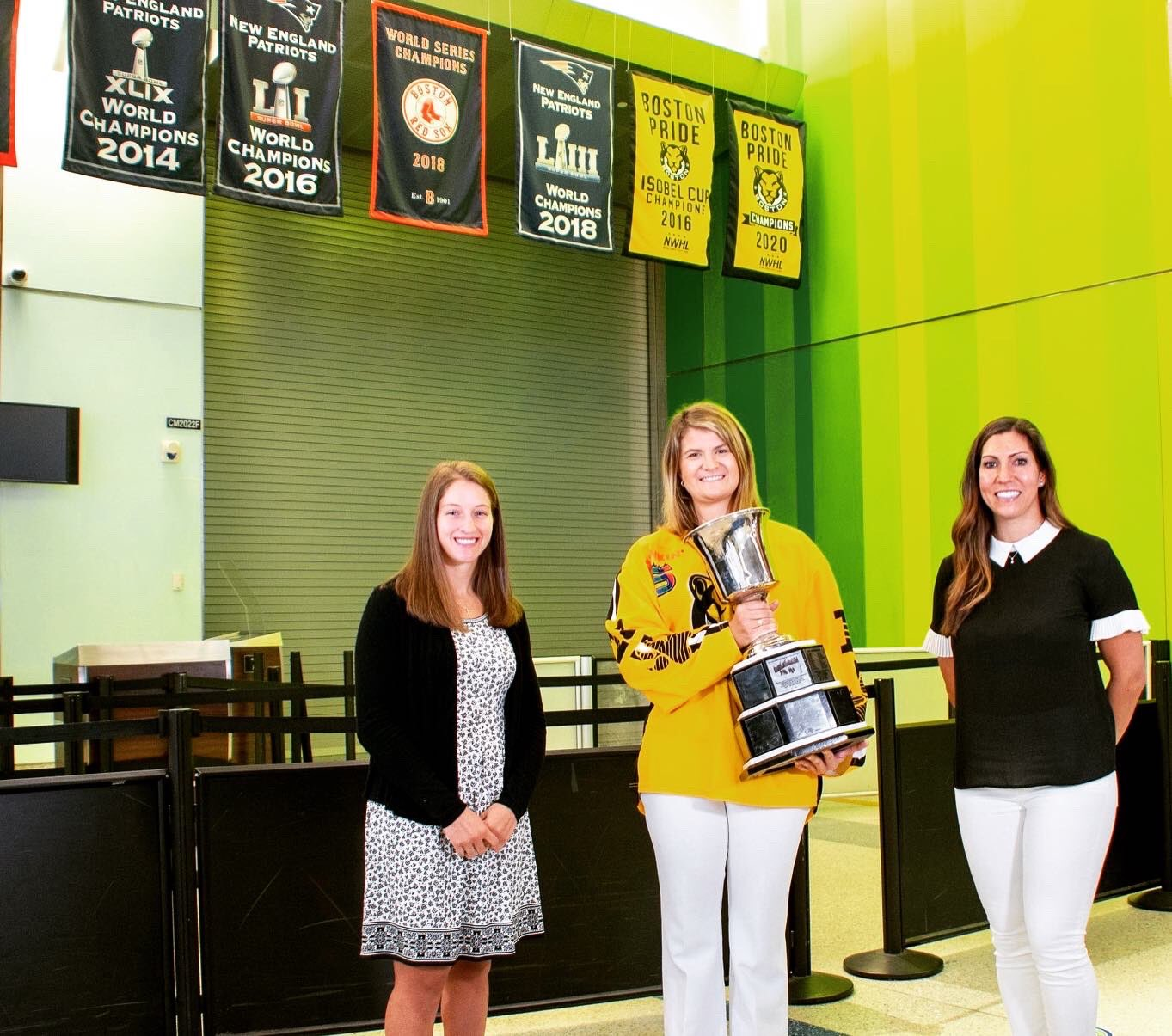 The Boston Pride hockey team have hung their championship banners at Logan Airport. ICL printed the banners for them.