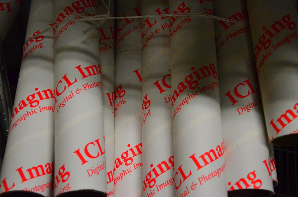 White Shipping Tubes imprinted with red ink saying ICL Imaging