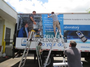 ICL Installing a Vehicle Wrap that we printed