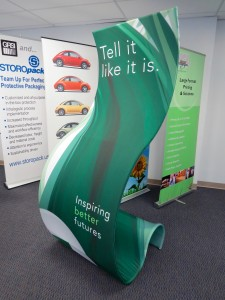 This is a fabric covered, double-sided curved base Banner Stand used for Trade Show Signage. Printing and fabric finishing by ICL Imaging