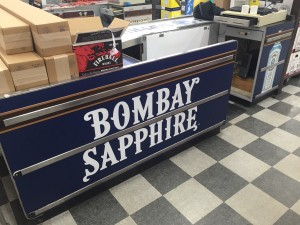 Liquor Store Check Out Counter covered in Adhesive Vinyl