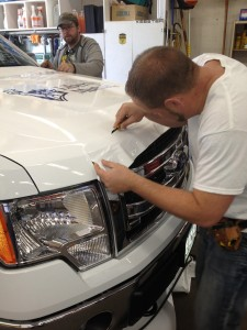 Installing Vehicle Wraps for Liberty Mutual printed by ICL Imaging