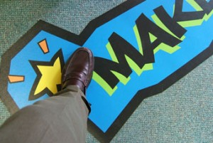 Floor Graphic with non-skid Overlamination adhered to carpet